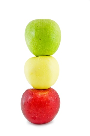Three apples-in traffic light form, on a white background.Isolated Stock Photo - 10228261