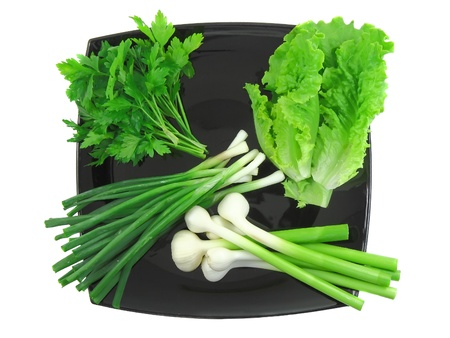 bine: Vegetable-young onion, garlic, parsley and letucce. Isolated. Stock Photo