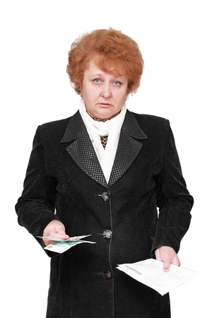Senior lady standing with apartament rent bill and money. Isolated over white. Stock Photo - 10275900