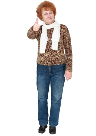 Senior lady standing showing thumbs up. Isolated over white photo