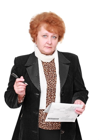 Senior lady standing with apartament rent bill. Isolated over white. Stock Photo - 10275822