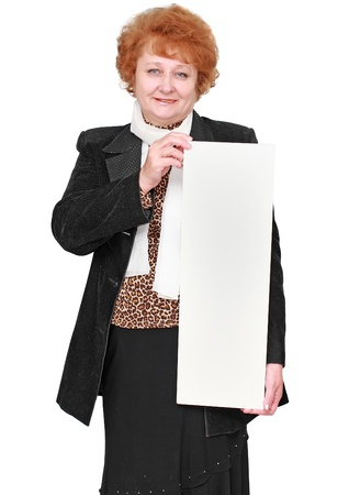 Senior lady standing with blank card. Isolated over white photo