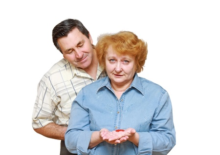 Old couple, wife hold  a small heart. Isolated over white Stock Photo - 10275759