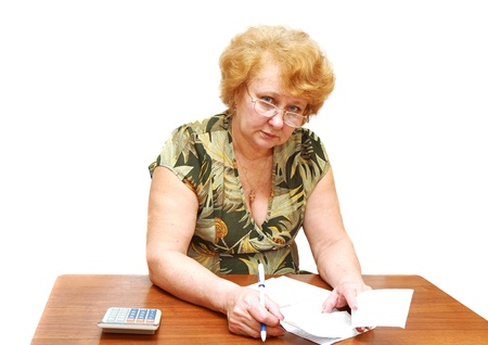 Senior lady check  apartament rent bill. Isolated over white. Stock Photo - 10275681