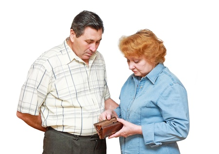 Pensioners with regret face. In hadns-empty wallet. Isolated Stock Photo