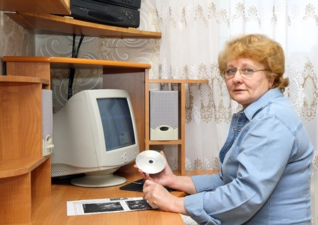 Senior lady learn a computer youself. photo