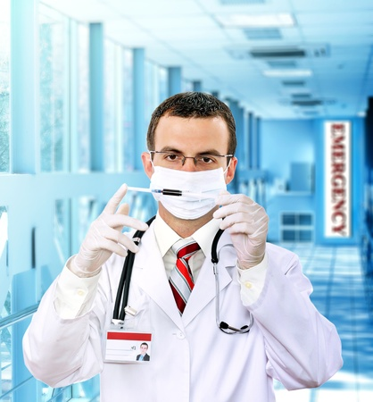 Doctor  resarch a medical test syringe with blood in Hospital. Stock Photo - 10276350
