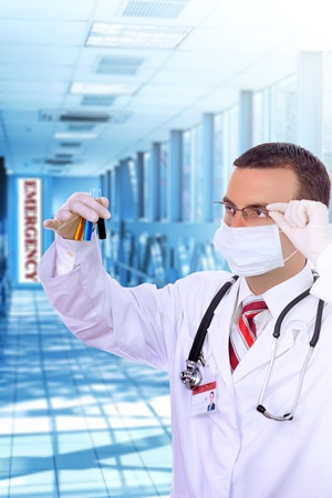 druggist: Doctor  resarch a medical test glass with blood in Hospital. Stock Photo