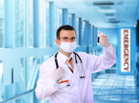 houseman: Doctor  resarch a medical test glass with blood in Hospital. Stock Photo