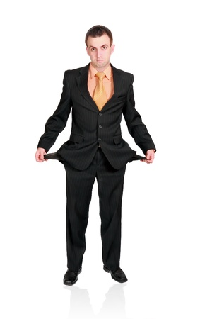Cheerful businessman show empty pockets. Isolated over white photo