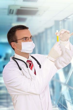 houseman: Doctor  resarch a medical test glass with urine  in Hospital. Stock Photo