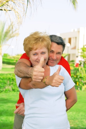 showed: Elderly couple showed up and thumbs-up All just fine! Stock Photo