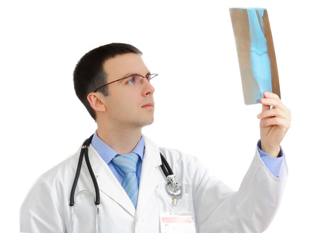surgical coat: Friendly medical doctor stand with a x-ray image and medical pad. Isolated