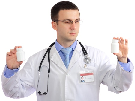 houseman: Friendly medical doctor with blank pills bottle. Close-Up. Isolated over white background. Stock Photo