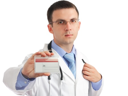 Friendly medical doctor with blank mediical IDs card .Isolated over white background photo