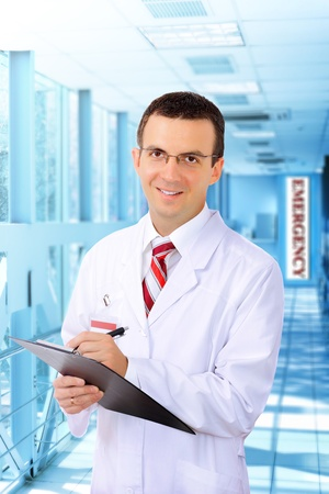Friendly medical doctor stand in Hospital corridor. Stock Photo - 10276440