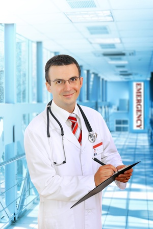 Friendly medical doctor stand in Hospital corridor. photo