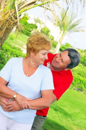 Elderly couple playfully looks at each other in tropical country. Stock Photo - 10275876