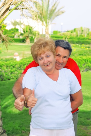 showed: Elderly couple showed up and thumbs-up All just fine!. Stock Photo