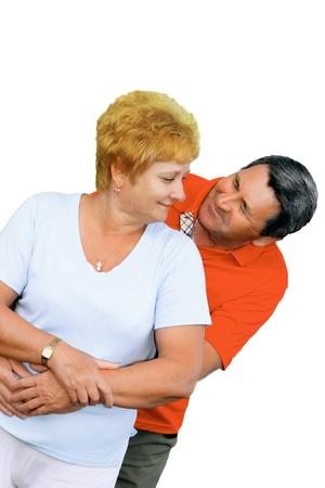 Elderly couple embrace each other . Isolated over white. Stock Photo - 10275765