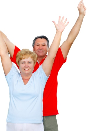 Elderly couple with hands-up. Isolated over white photo