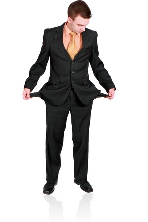 moneyless: Cheerful businessman show empty pockets. Isolated over white