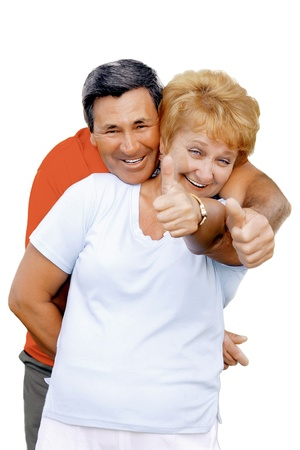 Elderly couple showed up and thumbs-up All just fine!. Isolated over white photo
