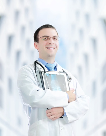 positiv: Doctor stand near the Hospital main Entrance. Outdoor Stock Photo
