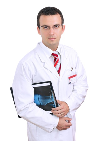 Friendly medical doctor stand with a x-ray image and medical pad. Isolated Stock Photo - 10275572