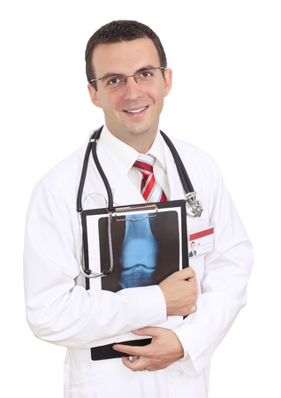 Friendly medical doctor stand with a x-ray image and medical pad. Isolated Stock Photo - 10275603