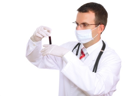 houseman: Doctor  resarch a medical test glass with blood . Isolated over white Stock Photo