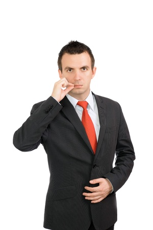 Cheerful young businessman be in a world by oneself- show gesture close mouth. Isolated photo