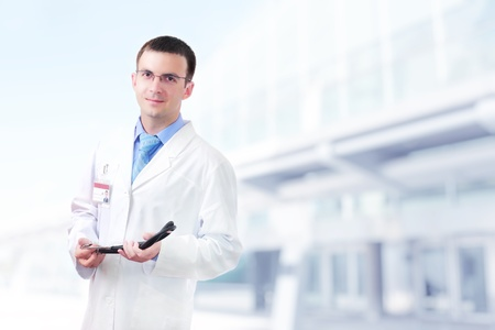 Doctor stand near the Hospital main Entrance. Outdoor Stock Photo - 10275405