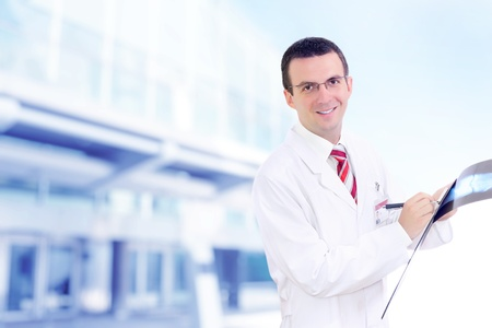 Doctor stand near the Hospital main Entrance. Outdoor Stock Photo - 10275465