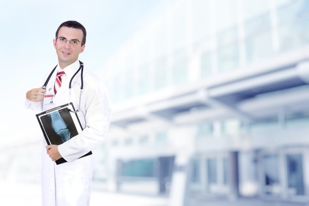 Doctor stand near the Hospital main Entrance. Outdoor Stock Photo - 10275449