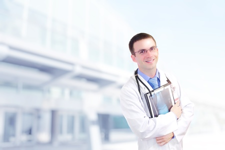 Doctor stand near the Hospital main Entrance. Outdoor Stock Photo - 10275406