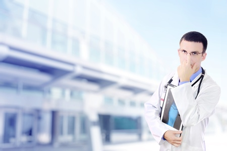 Doctor stand near the Hospital main Entrance. Outdoor Stock Photo - 10275481