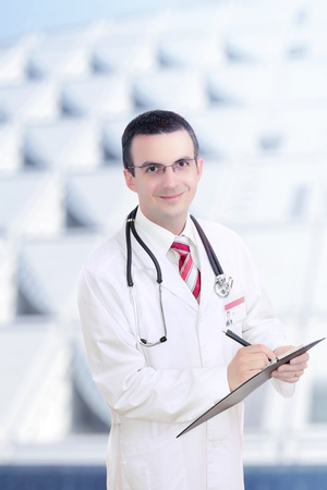Doctor stand near the Hospital main Entrance. Outdoor Stock Photo - 10275581