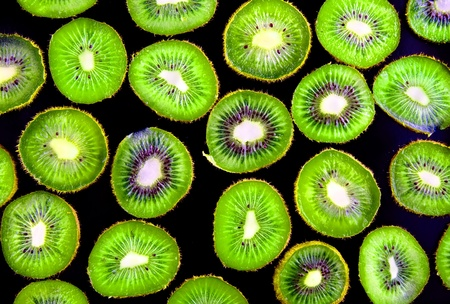 Abstract  slice of kiwi on black background(as wallpaper or backdrop). photo