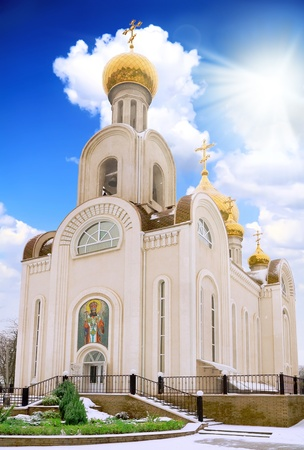 Old Temple with blue sky and sun. Rostov-on-don photo