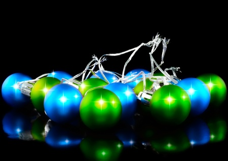 Christmas and New Year decoration-coloured balls. On the black background. photo