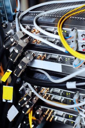 Telecommunication equipment of network cables in a datacenter of mobile operator.