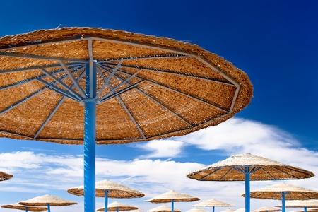 timeshare: Beauty landscape  of  sun umbrella, make of reed , bedstone and water pool. Stock Photo