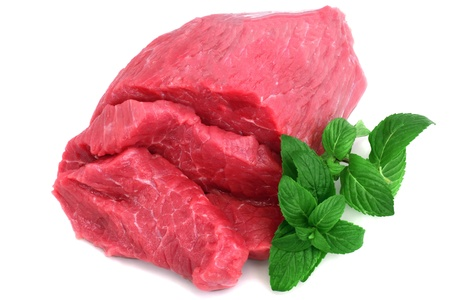 beef meat: Cut of  beef steak with green leaf. Isolated. Stock Photo