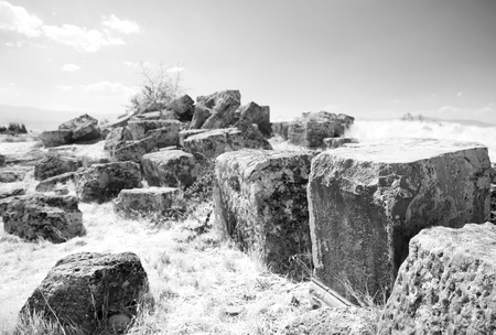 The big square stones which have remained after building of an ancient temple. Pamukkale. Turkey Stock Photo - 11281614