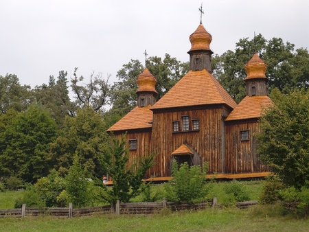 Old  wooden church in the Ukrainian Village. Near Kyev city photo