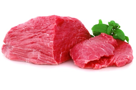 beef tenderloin: Cut of  beef steak with green leaf. Isolated. Stock Photo