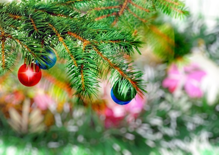 Christmas and New Year decoration- glass balls, green tinsel . Close-Up. On white background, isolated. photo