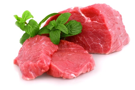 beef steak: Cut of  beef steak with green leaf. Isolated. Stock Photo