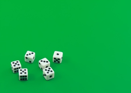 The dices on green background. photo